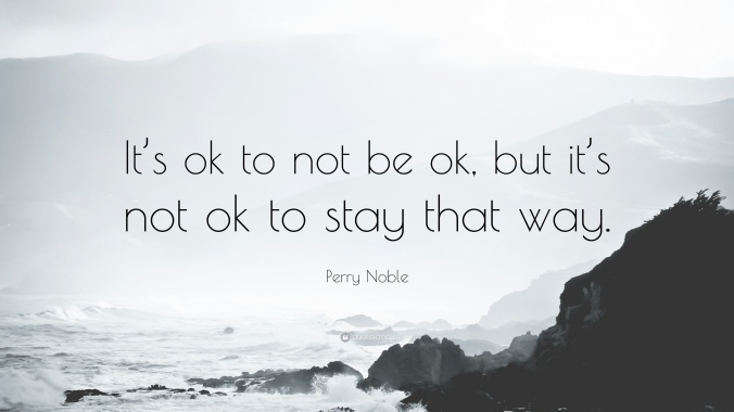 It's OK to not be OK. But It's Not OK to stay that way. Picture has mountains and water with a cloudy sky
